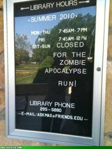 Library sign states its weekend hours: Closed for the zombie apocalypse