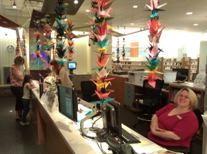 Cranes hang at the Children's Services desk