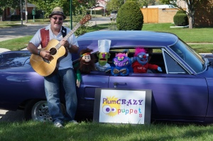 plum puppets in a car
