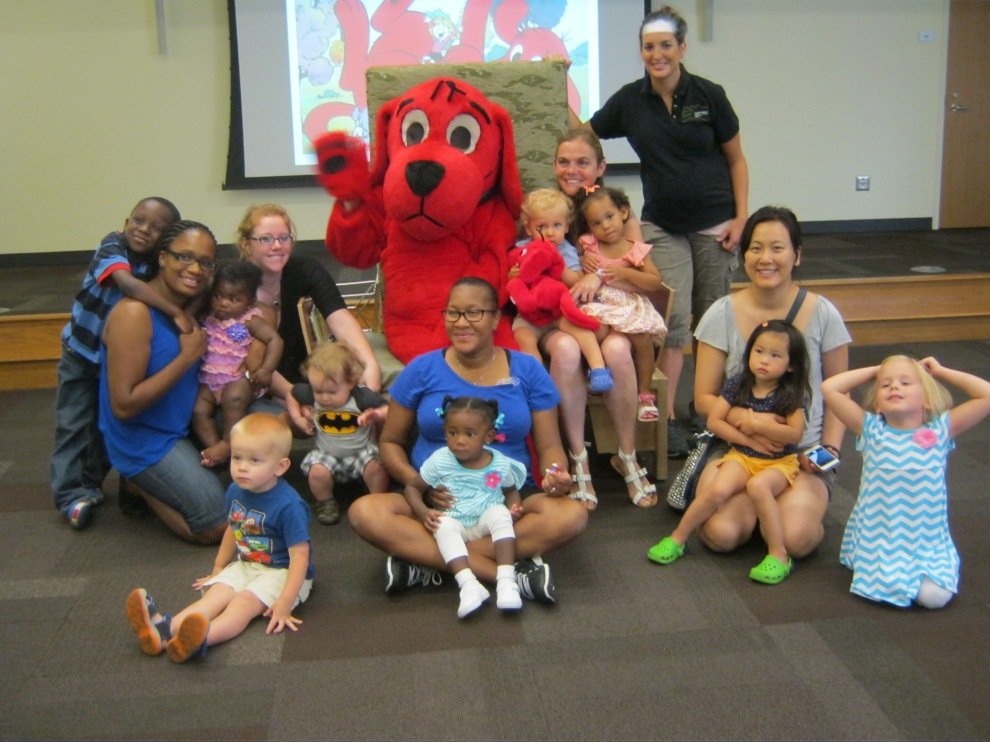 children sitting with Clifford