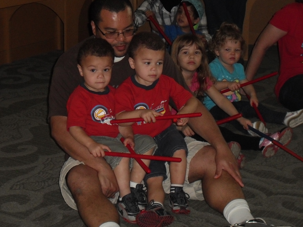 family with rhythm sticks